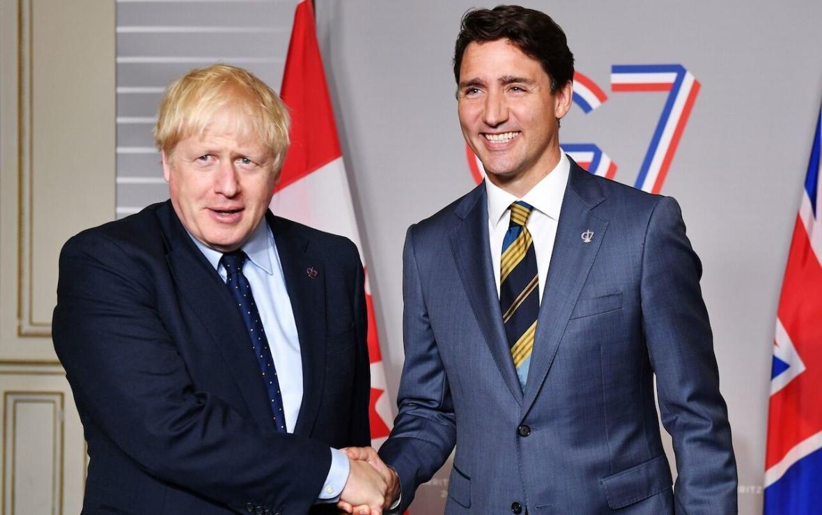 خبرنگاران انگلیس و کانادا توافقنامه تجاری امضاء کردند